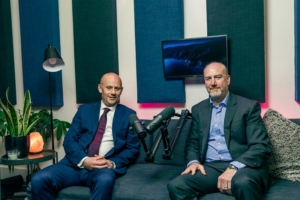 MSB Solicitors podcast Mark Forman and Neil Kelly sat on a sofa either side of a microphone